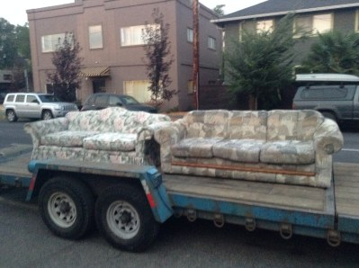 Couch on flatbed truck